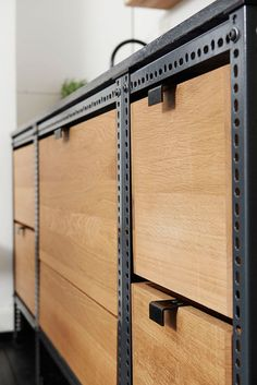 Interior Design Details - Industrial Close Ups // Light wood crates contrast the dark metal frame and pull tabs on this small industrial kitchen unit.