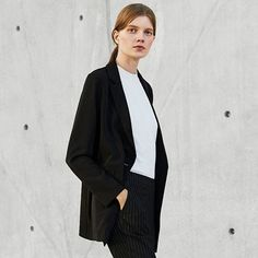 This elegant Drape Long Jacket is a must-have for every fashionista. The single button and trendy cut complement the material's supple texture to create a lovely feminine style. Available in 3 colours.  Model is wearing Drape Long Jacket ($59.90), UV Cut Sleeveless Sweater ($29.90) and Smart Style Ankle Length Stripe Pants ($49.90). #uniqlosg #drape #longjacket #uvcut #sweater #anklepants #ootd