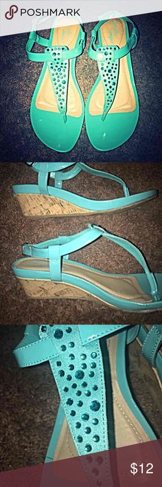 Blue Sandals Size:8.5 Dexflex Comfort Turquoise Sandals, really cute, sequins in tact, rarely used! 1 inch cork wedges and a little bit of bling on the straps. Barely worn, very good condition. Only one scuff on the back of the right shoe that you can barely see. ( as seen in the pick) Please let me know if you have any questions! Thank you!! Deflex Comfort Shoes Sandals