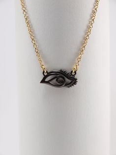 This necklace has an oxydized sterling silver eye charm and a gold plated chain. Eye Necklace, Pendant Necklace, Pendants, Necklaces, Sterling Silver, Chain, Eyes, Stone, Gold