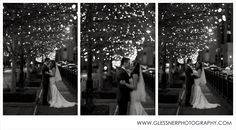 Bride and groom under the Christmas lights in front of the Schermerhorn Symphony Center | Claire+Spence's Winter Holiday Wedding at aVenue in downtown Nashville | ©2013 Glessner Photography