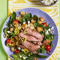 Warm Greek Salad with Sliced Steak.