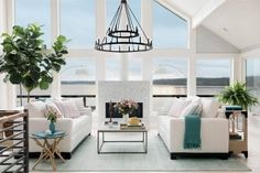 This bright and spacious great room at HGTV Dream Home 2018 feels light and airy while keeping the focus on the stunning seaside views in this renovated living space.