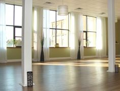 Example of draped curtains to soften room  Humble Warrior Yoga Studio