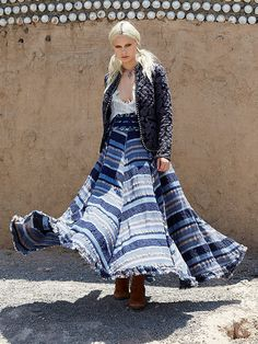 From looking easy and effortless during summer, to appearing warm and comfortable during fall, a great maxi skirt will keep you going regardless of season.  Teamed to a silky blouse and a paisley quilted jacket, allow your favorite voluminous skirt to look fall-ready, styled with boho jewels and suede boots.