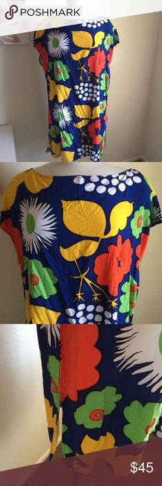 Marimekko dress Gorgeous dress! It has a rounded neckline. It has bright and bold patterns on it. Very lightweight and flowy. 100% rayon. It can be a dress or tunic depending on your height. New with tags Marimekko Dresses