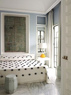 Tangier oasis of Bruno Frisoni and his partner Hervé Van der Straeten. The bedroom features a pom pom blanket. Photography: Philippe Garcia via AD France.