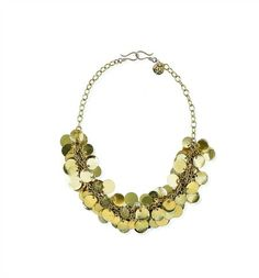 "ELEGANCE  $73.00 SKU: 12-0049 ""A generous cluster of gold textured coins shine beautifully as a shorter necklace or layered with Raven as a longer necklace or belt."""
