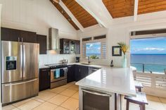 Cooking isn't a chore when you've got a spectacular view in front of you. This airy oceanfront home in Hawaii has a spacious kitchen with stainless steel appliances and soaring ceilings. Rate: $900/night   - HouseBeautiful.com