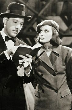 'Ninotchka', 1939 - Starring Greta Garbo & Melvyn Douglas - Ernst Lubitsch Directed this Satirical, Russian Romantic Comedy with the Divine Greta Garbo, mostly noted for her dramatic roles - But here, 'Garbo Laughs' - Featured on 'TCMs 31 Days of Oscar'. Golden Age Of Hollywood, Vintage Hollywood, Classic Hollywood, Classic Man, Classic Films, I Movie, Movie Stars, Melvyn Douglas, Star Show