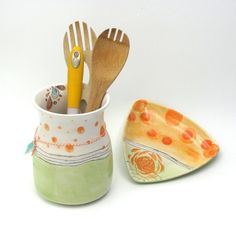 The best way to remember summer is with the fun colors of oranges, mint green, and a bit of turquoise.  What better way to make memories with the family?  https://www.etsy.com/listing/532006376/colorful-ceramic-caddy-spoon-rest  #
