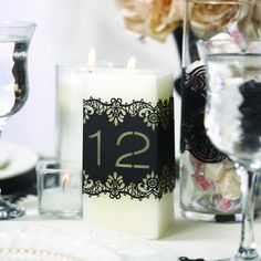 Add elegance to your centerpieces with these black decoration wraps, featuring the numbers 11-20. Clear seals are included to secure the wraps around candles, wine bottles and more without leaving a tacky line.