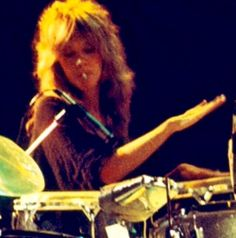 a rare photo of Stevie ♫♥❤♥♫ with a Kools cigarette in her mouth while she's fiddling around on a drum set; or maybe the cigarette is weed