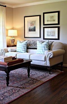 black frames w white mats    tan wall    pillows    white curtains