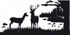 Ciervo con ciervos pastando en