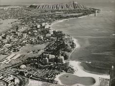 """Beautifully detailed black & white by Pacific Area Travel Association from around the time of the Elvis movie """"Blue Hawaii"""" in which there are brief glimpses of the Waikiki Shore Apartments under construction.  Photo notes - 1955 Hawaiian Village Hotel, bottom of picture - 1957 Ocean Tower, 1958 Village Tower, and 1960 Diamond Head Tower at the Hawaiian Village are all up - 1962 Foster Tower not yet built"""