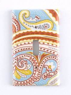 fabric- or scrapbook paper covered-switchplate to add color/pattern/fun to a room
