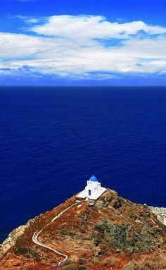 Visit the chapel that sits atop the rocks of Kastro, a village found on the island of Sifnos in Greece.