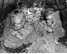 -Aerial view of construction of Mt. Rushmore...