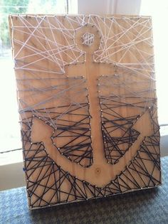 anchor string art. love this!  Already have a big anchor to use and this would probably sell easily in my etsy shop. Score