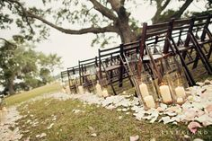 Candles and petals at outdoor wedding ceremony