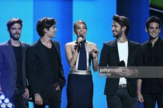Leslie Grace (C) with music group Dvicio speak onstage during Telemundo's Latin American Music Awards 2015 at Dolby Theatre on October 8, 2015 in Hollywood, California.