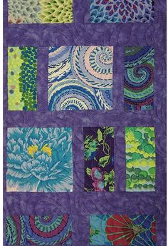 "Kaffe's Blue City Life Quilt, 74.5 x 89"", designed by Christine Conner. ""Pick Up A 6 Pack"" quilt pattern book."