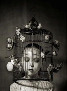 Girl in bird cage