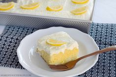 Lemon lovers, this easy Triple Lemon Poke Cake is for you! Soft lemon cake is soaked with lemon Jell-o and topped with a gloriously fluffy lemon frosting!