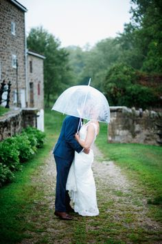 Bride and Groom in the Rain at the John James Audubon Center | Marisa Bridals | Calvin Klein | Buttercup At Jam | Off BEET Productions https://www.theknot.com/marketplace/off-beet-productions-fair-haven-nj-814232