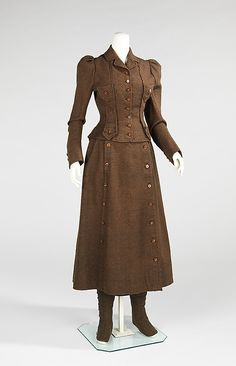 Brown wool cycling suit, American, 1896-98. A past time originally dominated by men, bicycling became more acceptable for women after Queen Victoria bought bicycles for her daughters. By the 1890s, clothing to be worn while cycling was being produced. This particular ensemble features a bifurcated skirt that allowed the rider a more comfortable ride while also giving the modest appearance of a skirt at front. This suit also includes a pair of gaiters, which provided protection for the legs.