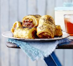Puff pastry bites with a spicy kick - team Spanish paprika sausage with sweet apple and top with poppy seeds