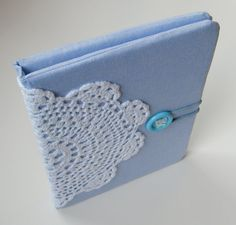 Gorgeous notebook cover, love the idea of using a doily as a decorative detail!