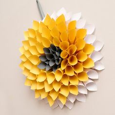 This paper dahlia wreath will have your home Spring ready for under $10. With unlimited color combinations, the possibilities are endless.