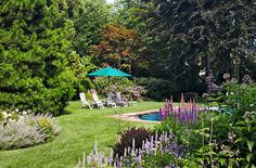 The property is landscaped with easy-care perennials, including veronica 'Icicle' and salvia 'Blue Spires.'
