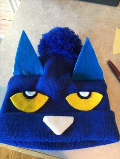 Hat from Old Navy with parts cut out of felt and hot glued. 3 layers of felt glued together make up the ears, which are hand stitched to the hat. Pete The Cat Costume, Cat Costume Kids, Teacher Halloween Costumes, Halloween Cat, Halloween 2018, Halloween Ideas, Happy Halloween, Book Costumes, Book Character Costumes