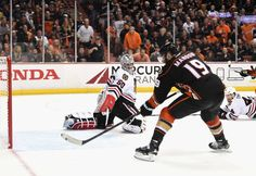 Goaltender Corey Crawford #50 of the Chicago Blackhawks watches the puck on the stick of Patrick Maroon #19 of the Anaheim Ducks who scores in the third period of Game Five of the Western Conference Finals