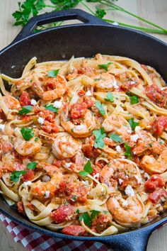 Shrimp Linguine in a #Tomato and #Feta Sauce. If you are looking for a quick and easy weeknight meal, this recipe fits the bill. Ready in under 30 minutes {seriously!}