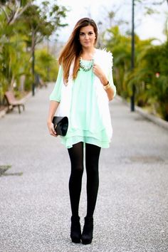 White fur vest over mint dress with black tights