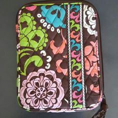 """Vera Bradley Lola tablet zipper sleeve NWOT The way we read has changed. So should our accessories. This colorful cover, with a convenient L-shaped opening, makes for easy access to your E-reader, while a lightweight protective foam keeps all of your favorite stories safe. A final touch, an inside pocket grants the perfect spot for an ID card. And they all lived happily ever after  6.1/4"""" x 8.1/2"""" x 3/4 ?NO LOWBALL OFFERS ? NO NEGOTIATING OVER COMMENT, USE OFFER BUTTON ? NO TRADES Vera…"""