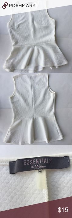 Essentials By Milano Peplum Top Essentials By Milano Peplum Top in cream. Textured material. Polyester and Spandex. Excellent condition. Essentials By Milano Tops