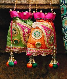Suhani Potli - A potli bag with gota and mirror work Indian Wedding Favors, Wedding Favours Luxury, Wedding Gifts, Kutch Work Designs, Handmade Fabric Bags, Potli Bags, Bridal Clutch, Work Bags, Handmade Jewelry Designs