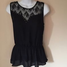 Black Sleeveless Top Lace at the shoulder, has elastic waist that gives a peplum look to this black sleeveless top. Silver studs line lace at chest. Tops Blouses