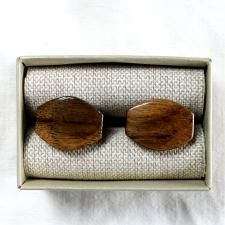 "Wooden design cuff links ""Tears of happiness dark"" handmade from a natural walnut wood are designed in a unique tear-drop shape. We hand sanded them to the finest detail. Combine with any model of our wooden bow ties. Get it for € 19.99."
