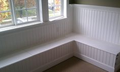 Create faux window seat with bench covered in bead board wallpaper