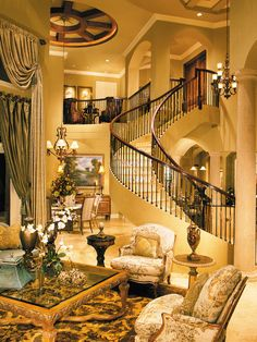 Amazing living room in Mediterranean style with a curved staircase and travertine tiles #travertine #floor #home #exterior #naturalstone #mediterraneanstyle #decor