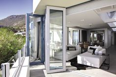 With sweeping views of the Atlantic Ocean, this chic apartment, in an affluent residential area of Cape Town, is home to a couple who enjoy spending their holidays near the sea. Apartment Chic, Atlantic Ocean, Cape Town, Canning, Homes, Couple, Sea, Holidays, Vacations