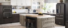 KitchenAid Black Stainless Kitchen Suite-Black matte appliances instead of stainless steel?! Yes please!  Oh, and those cabinet colors are perfection (especially the island!)
