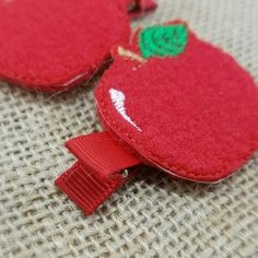 These cute little apple hair clips are so cute with pigtails! First day of school is coming up quickly, grab a pair of these while you can!