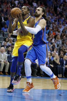 Oklahoma City's Steven Adams (12) fouls Golden State's Kevin Durant (35) during the NBA basketball game between the Oklahoma City Thunder and the Golden State Warriors at the Chesapeake Energy Arena, Tuesday, April 3, 2018. Photo by Sarah Phipps, The Oklahoman